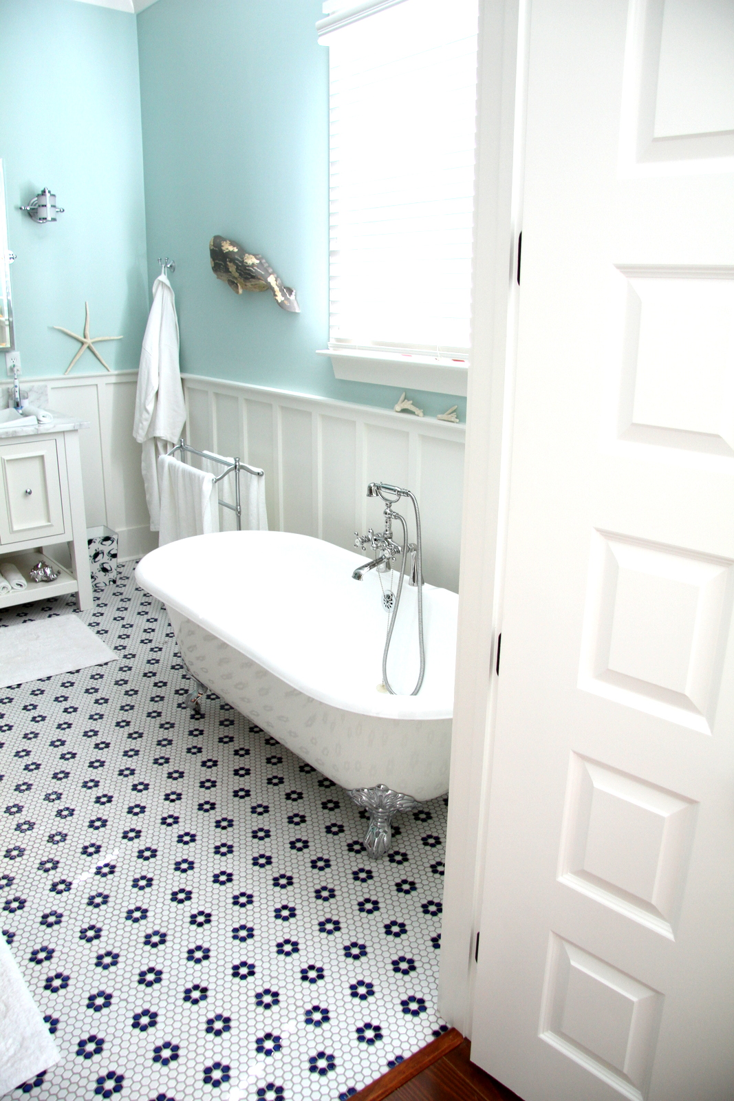 Floor tiles and clawfoot tubs are often used in our traditional Coastal homes from Thornhill Construction.