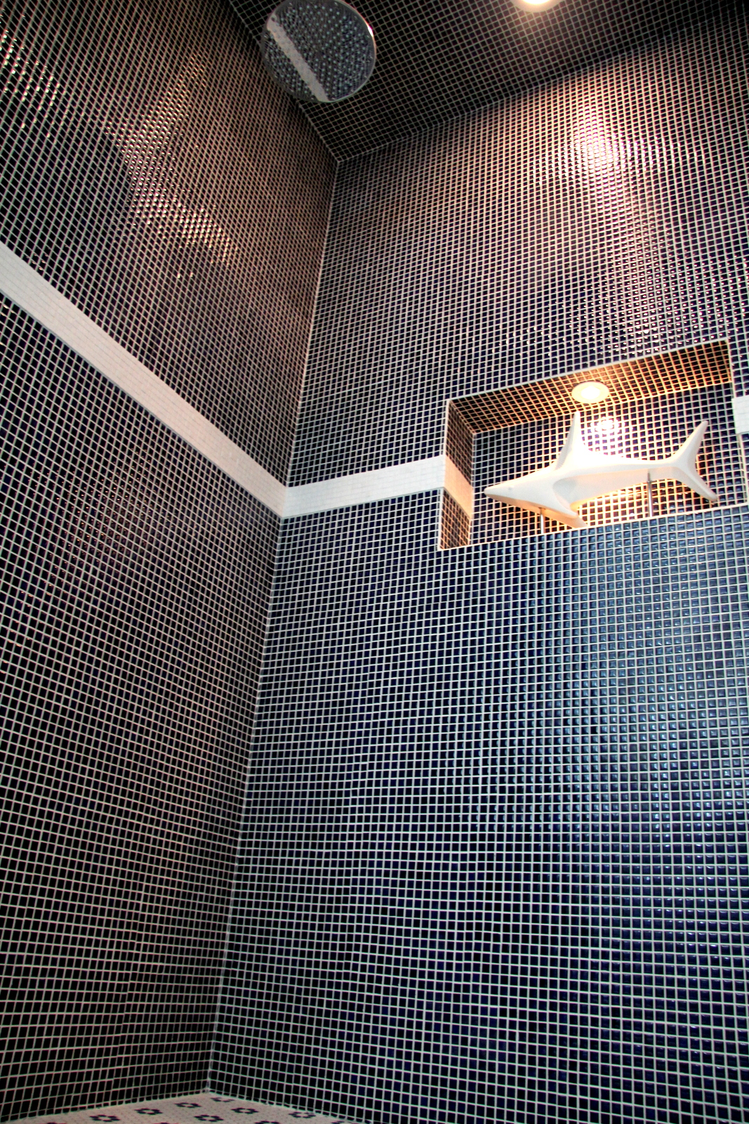 Tiled Showers and wonderful built in shelves can provide comfort and fun, while remaining elegant coastal baths from Thornhill Construction.