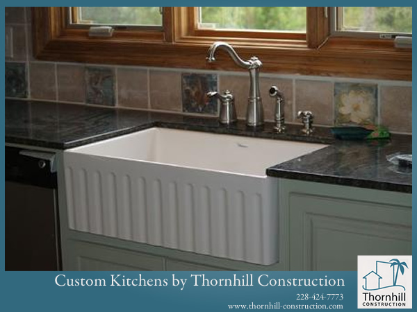 Coastal Countertops and Sinks with beautiful faucets are key to Custom Kitchens by Thornhill Construction.